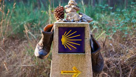 Hiking boots and stone on the stone signal, Symbol of the way of St. James