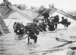 Troops from the 48th Royal Marines at Saint-Aubin-sur-mer on Juno Beach, Normandy, France, during the D-Day landings, 6th June 1944. Photo: Hulton Archive/Getty Images