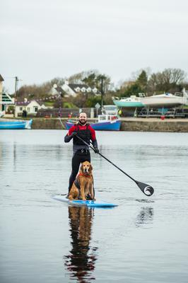 All aboard: Thomas and Vipp paddleboarding together in Kinvara harbour. Photo: Julia Dunin Photography