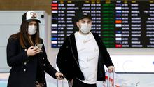 Passengers wearing protective masks in Ben Gurion International Airport, near Tel Aviv, on February 27, 2020. Photo by JACK GUEZ/AFP via Getty Images