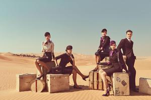 Etihad crew pose in uniforms created by Italian Haute Couturier Ettore Bilotta. Photoshoot by Norman Jean Roy.
