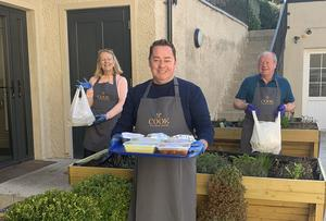 Neven Maguire and volunteers with some of the meals they prepared for vulnerable community members around Blacklion, Co Cavan.