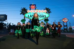 A dancer from Sharon Lynn Academy of Irish Dance performed as The Las Vegas Convention and Visitors Authority (LVCVA) turned the historic 'Welcome' sign in partnership with Tourism Ireland in 2018. It will go green again this year. PHOTO: Sam Morris/Las Vegas News Bureau