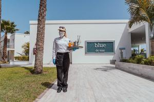 A service staff member awaits guests on Lanzarote