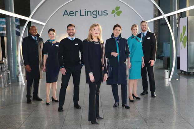Designer Louise Kennedy pictured with Aer Lingus cabin crew at the unveiling of the new look Aer Lingus uniform. Photograph: Leon Farrell / Photocall Ireland