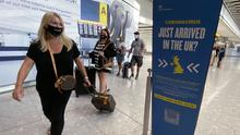 International arrivals to England and Scotland must test negative for Covid-19 (Yui Mok/PA)