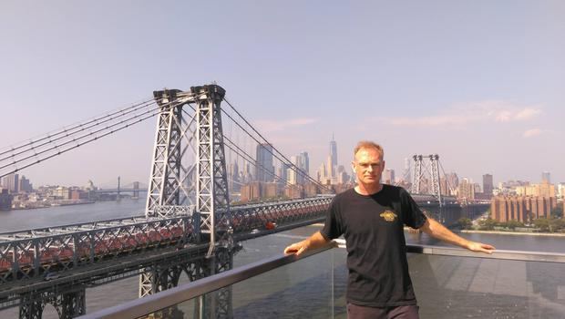 Shane in front of the Williamsburg Bridge on the Brooklyn side