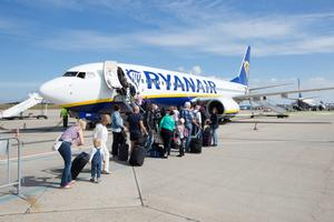 Frankfurt-Hahn Airport. Passengers board a Ryanair passenger plane. Photo by Ulrich Baumgarrten via Getty Images