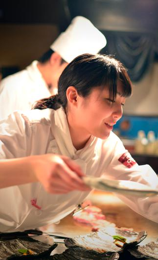Chefs serve up the courses at Presdient chibo, Osaka.