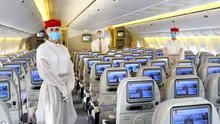 Cabin crew wearing PPE (Personal Protective Equipment) on an Emirates flight