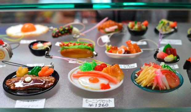 Phone trinkets in Osaka. Plastic food is common in restaurant windows, and miniature versions are sold as keepsakes to attach to smartphones.