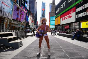 A view of the famous 'Naked Cowboy' wearing a mask in Times Square, amid the coronavirus (COVID-19) outbreak on March 24, 2020 in New York City (Photo by John Nacion/NurPhoto via Getty Images)