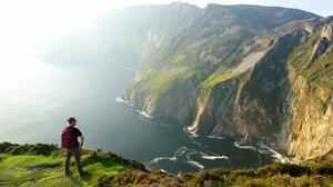 A tourist at Slieve League, Ireland's highest sea cliffs, located in south-west Donegal.