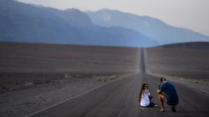 Tourists  stop to take pictures along Badwater Road early Saturday. Washington Post photo by Melina Mara