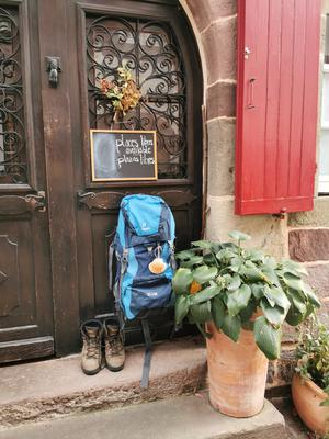 A Camino walker makes a pitstop outside a hostel