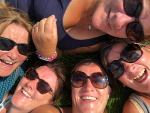 """""""This photo is so special because it's five sisters together celebrating a big birthday that was meant to happen in Florence, Italy but here we are lying on our backs on the cliffs of Moher, laughing looking up at the blue sky enjoying being with each other and forgetting the real world problems for a little while,"""" says Helen Boxwell."""
