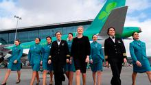 Dublin Airport Duty Manager Sharon Carlyle leads the Flight Crew, Cabin Crew and Guest Service Agents ahead of Aer Lingus flight EI162. Photo: MaxwellPhotography.ie