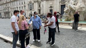 A vendor approaches tourists on Piazza Nanova in Rome on June 2, 2021. Washington Post photo by Chico Harlan