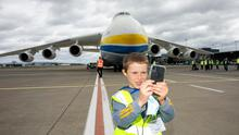 Eight-year-old Colin Slattery from Lissycasey Co Clare, gets a close-up view of the Antonov AN-225 at Shannon Airport today. Photo: Arthur Ellis.