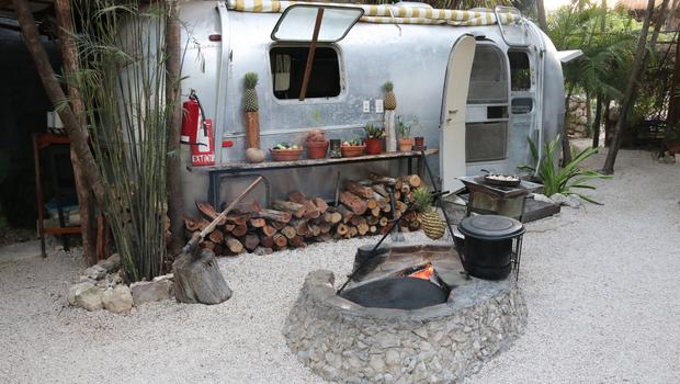 The Airstream-turned-kitchen and outdoor fire pit at Safari Tulum in Tulum, Mexico. Photo for The Washington Post by Nevin Martell
