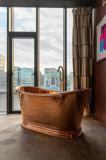 Wow factor: the Warehouse Suites have a freestanding copper bathtub which overlooks the Liffey