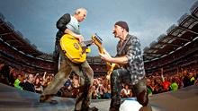 Adam Clayton and The Edge perform during U2's 360 Degrees World Tour at Croke Park on July 25, 2009. Photo by Neil Lupin/Redferns)