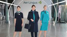 Pictured are Aer Lingus Cabin Crew members (l to r) Eszter Dornfeld, Aoife Costello and Victoria Elmore pictured at the unveiling of Aer Lingus' new look uniform designed by Louise Kennedy. Photograph: Leon Farrell / Photocall Ireland
