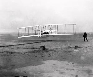 The first powered flight, made by Orville Wright on 17 December 1903 near Kill Devil Hill, Kitty Hawk, North Carolina. Wright can be seen lying on the lower wing of the 12 horse- power, chain-driven Flyer I. The flight lasted for about 12 seconds, covering a distance of 36.5 metres (120 feet) at an airspeed of 48 kilometres/ hour (30 miles/hour), a groundspeed of 10.9 kilometres/hour (6.8 miles/hour) and an altitude of 2.5-3.5 metres (8-12 feet). Photo: Getty Images/Science Photo Libra