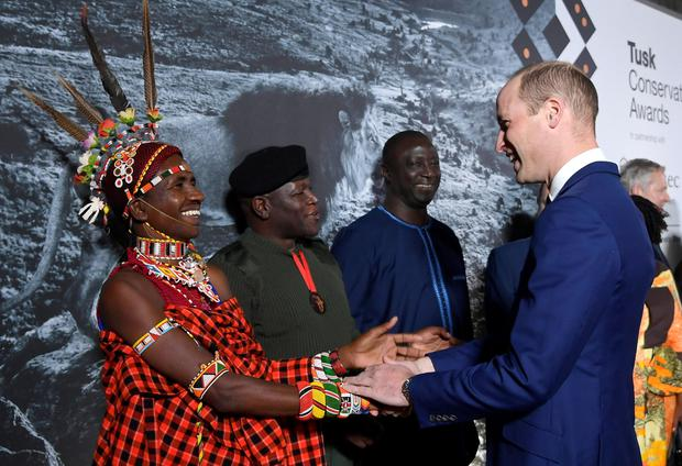 Award finalist Jeneria Lekilelei is congratulated by the Duke of Cambridge during the Tusk Conservation Awards at the Empire Cinema in Leicester Square, London. PA Photo/Toby Melville.