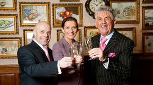 Hoteliers Marc Gysling and Deirdre McGlone celebrate Harvey's Point's Hotel of the Year Award from TripAdvisor. File photo.