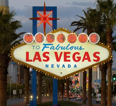 The famous neon sign welcomes millions of visitors to Las Vegas each year.