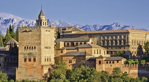 The Alhambra palace complex sits on a hilltop overlooking Granada.