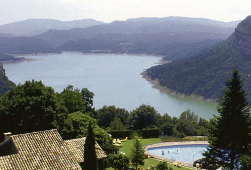 BREATHTAKING: Parador Vic-Sau is a converted farmhouse surrounded by trees and set high above a beautiful lake