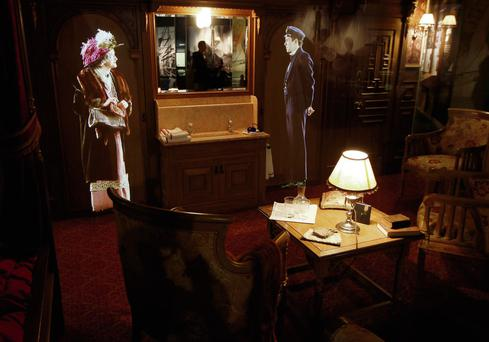 MUSEUM: In Titanic Belfast, images of people are projected on a wall in a replica first-class cabin. The tragedy saw the class divide starkly demonstrated, with more first class surviving.