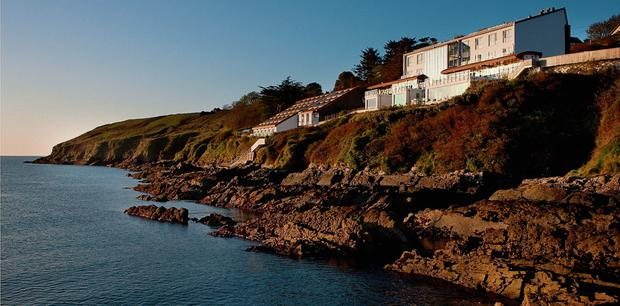 SPECTACULAR: The Cliff House Hotel at Ardmore, Co Waterford, enjoys an idyllic position, jutting out from rocks overlooking the sea. Having undergone a transformation, this boutique hotel offers five-star luxury and service to its clients. Dogs can also stay in kennels there