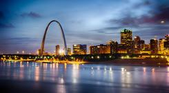 The iconic Gateway Arch beside the mighty Mississippi river welcomes visitors to the city of St Louis, Missouri