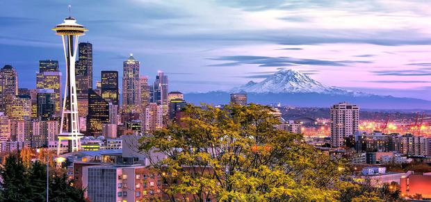 Blissed out: The view of Seattle from Kerry Park, taking in the Space Needle and Mount Rainier - the 21st highest mountain in the world