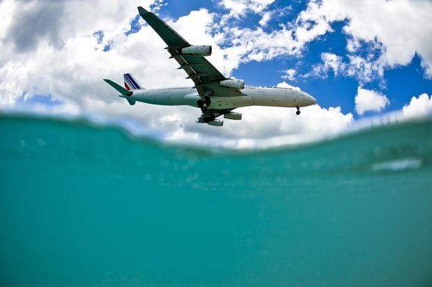 An airplane approaches the runway at Princess Juliana International Airport, St. Maarten. Photo: Getty Images/Flickr Open