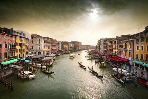 Boats and gondolas on the Grand Canal, Venice, Italy.