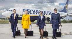Ryanair cabin crew model the airline's new uniforms. Photo: Taine King
