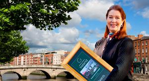 Composite: Georgina Campbell announcing her annual awards (Dublin in background).