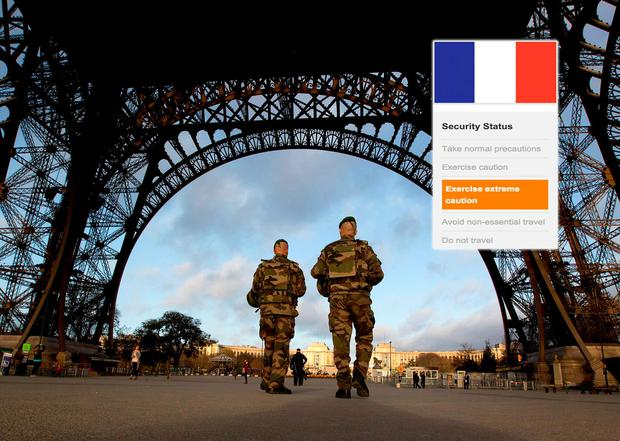 French soldiers patrol at the Eiffel Tower following terrorist attacks on Paris on November 13, 2015. Inset: Travellers to France should 'exercise extreme caution', according to the Department of Foreign Affairs. AP Photo/Peter Dejong)
