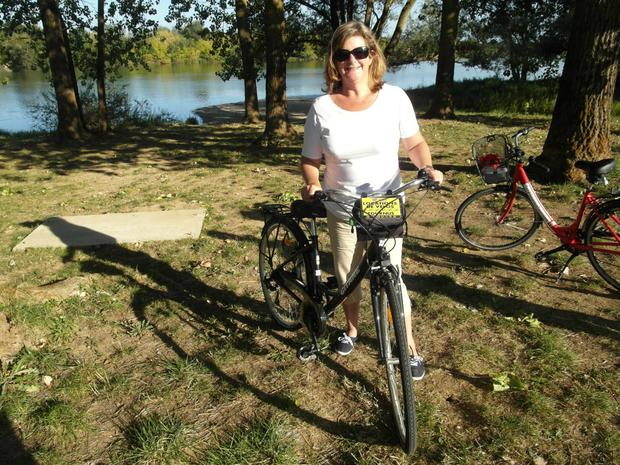 On your velo: Madeleine Keane takes a breather during her 14-kilometre cycle on La Voie Bleue along the river Saone.
