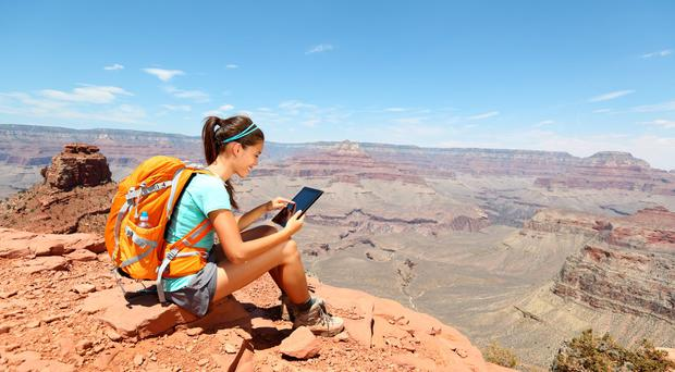 Hiking with a tablet in the Grand Canyon. Photo: Deposit