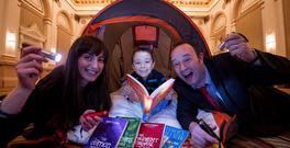 Irish authors Erika McGann and Alan Nolan are pictured with Erwin Csosz (5) from Dublin, at the launch The Westin Dublin's Family Glamping in the City package. Photo: Andres Poveda