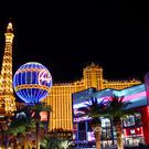 Las Vegas, USA: The Paris Las Vegas with replicas of the Eiffel Tower and the Montgolfier Balloon adorned in bright lights.