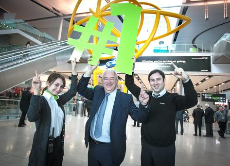 Celebrating the No. 1 spot for passenger service are (LtoR) Dublin Airport Terminal Services Officer Yanina Khizhinskaya with Dublin Airport Managing Director, Vincent Harrison and Terminal Services Officer, Niall Feiritear.