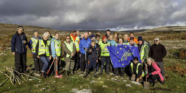 Representatives of the Burren and Cliffs of Moher Geopark and Burren Beo Trust Conservation Volunteers pictured with Costas Christ from the National Geographic in the Burren. Photo: John Meyler