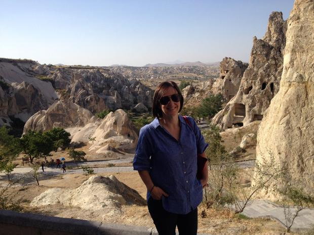 Gemma in Goreme Open Air Museum. To the right you can see where caves have been carved out of soft tuff rock.