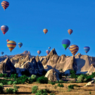 Hot air balloons float of the spectacular landscape of Cappadocia in Turkey's central Anatolia region.